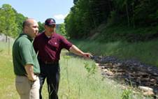 Engineer Ed Hansalik explains to Chief Lancaster restoration efforts in Alstead NH.