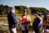 Students working with an NRCS engineer on salt marsh restoration.