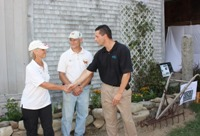 Photo of Rick Ellsmore congratulating Carole Soule and Bruce Dawson for their new People's Garden