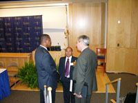 Dr. Wilkes converses with U.S. Senator Whitehouse and State Con Vongkhamdy