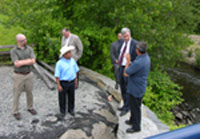 NRCS staff discusses the fish ladder project with Senator Whitehouse