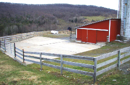 Web image: Curbs installed along the edges of this concrete barnyard facilitates the cleaning of wastes, reducing the amount of contaminants leaving the area. Click photo for full page view