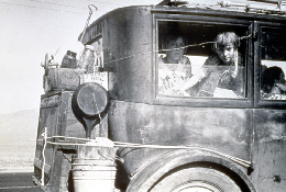Web image: Photo from the Dust Bowl era. A family moving their belongings in a truck. Click photo for full page view