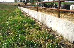 Web image: Weep holes in this concrete barnyard allow runoff to exit the area into a grassed filter strip which captures contaminants. Click photo for full page view