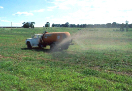 Web image: Photo of a truck with a tank applying nutrients to a field. Click photo for full page view