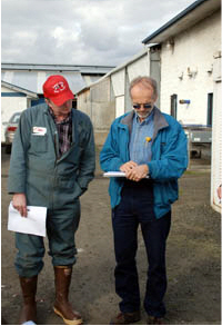 A professional energy auditor gathering information from a farmer