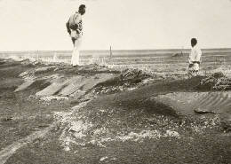 Web image: Photo of a farmer viewing the devastation from soil erosion during the Dust Bowl era. Click photo for full page view