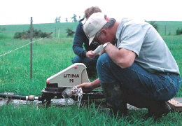 Web image: Photo of a watering pump which is operated by the animals nudging it . Click photo for full page view