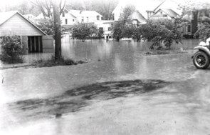 Web image: Photo of floodwaters inundating a residential area along Wilson Avenue, Bath, New York. July 8, 1935. Click photo for full page view