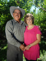 image: Orchard owner Sergio Marquez (left) and his wife Lilia.