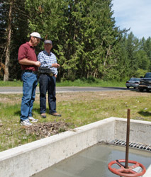 All the water needs for the Sequim Prairie Tri Irrigation Association begins at this inlet structure where Leigh Nelson, NRCS State Irrigation Engineer, and Gary Smith, calculate the flow of water entering the first stage of the irrigation system.