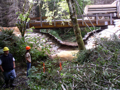 Image: New bridge looking upstream—Chris Wright, Soil Conservation Technician and Jennifer Johnston, NRCS Engineer.