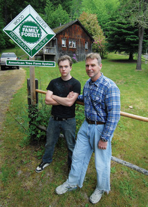 John Keller (right) and his son Billy, are pictured here outside the family's forest cabin in Cowlitz County. For four generations, the Kellers have enjoyed recreating in, and caring, for their privately owned forest.
