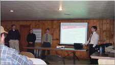Washington State University Civil Engineering student, Tyler Dester presents a senior class team project, Anatone Sewer Project, to local homeowners at the Anatone Community Hall, last December 5, 2006. Photo credit to Cheryl Sonnen, Asotin County Conservation District (ACCD).
