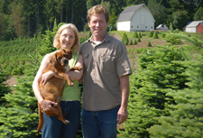 Image: Denise, at left holding their dog Sammy, and Jim Wilder own and operate a Christmas tree farm in Clark County Washington.