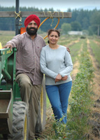 Gurmeet Singh and Ranbeer Déaliwal installed a drip irrigation system to precisely control watering in their blueberry fields through EQIP.