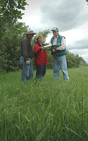 Jason and Debbie VanderVeen review their conservation goals with John Gillies, NRCS resource conservationist.