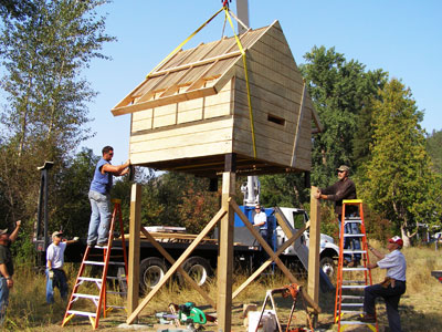 Image of bat condo being set on posts by a crew from the Inland Northwest Wildlife Council.