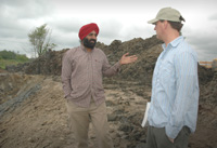 Gurmeet Singh discuss conservation goals and objectives with Travis Bouma, NRCS soil conservation technician.