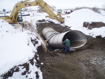 Image of siphon installation for ditch water.