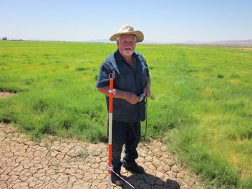 John Hunt at native seed planting site
