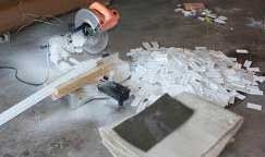 Photo shows material cut with miter saw.