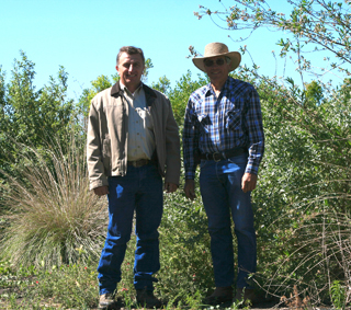 NRCS Field Conservationist Dan Taverner and walnut farmer Fred Stolp.