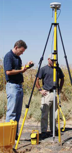 NRCS Engineer Jon Chilcote (left) and Biologist Richard Rivas use a Global Positioning System device to stakeout wetland construction.