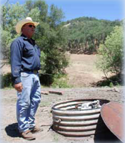 Hall's challenge was how to move water from this well to the top of the mountain behind him – a 420-foot rise in elevation.