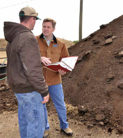 Konzen talks with NRCS District Conservationist Chris Hartley about his use of manure on the farm.