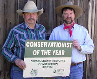 Fred Langdon, left, and John Reader earned conservationist honors for their stewardship of natural resources.