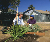 NRCS Conservationist providing assistance to a homeowner to establish a community garden