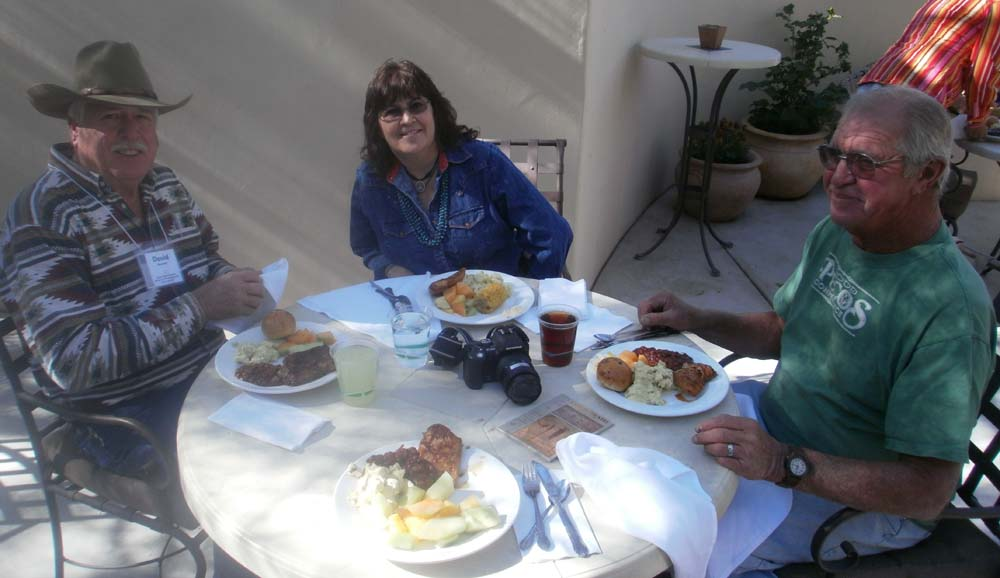 Dave Bancroft, Darlene Brinkerhoff and Ralf Kurzhals enjoy their meal at the December employee awards ceremony.