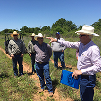 Rancher Diaz Murray talks to the group about his management practices and recent weather events.