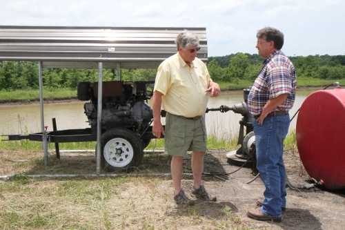 Pete Hunter (left)and Kevin Kennedy (NRCS) discuss the instillation of a TailWater pumping system in Coahoma County.