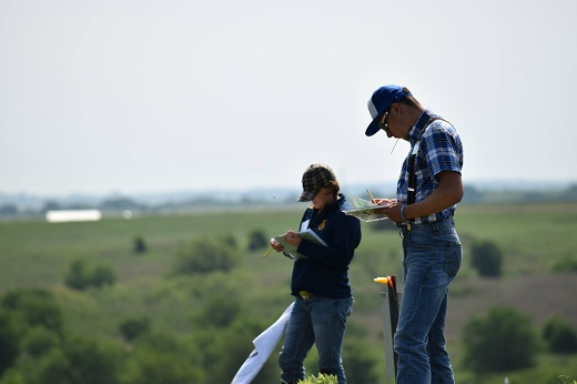 Range judging contestants check their plant identification notes during the 2015 contest held on Cheyenne-Arapaho Tribal lands in Concho, Oklahoma.