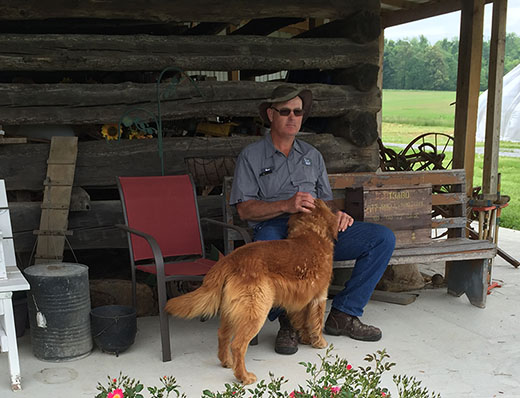 Mark Turner sits on the front porch of his family farm