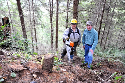 Kevin Goodell (left), a member of the Confederated Tribes of Siletz Indians and tribal natural resources crew member, and Mike Kennedy, natural resources director for the Siletz Tribe.