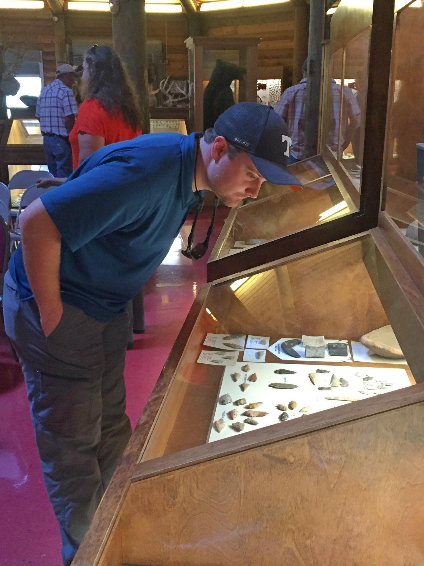 Nathan Mangrum looks at a display of artifacts.