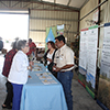USDA-Farm Service Agency and NRCS staff visit with workshop attendees at their booths.