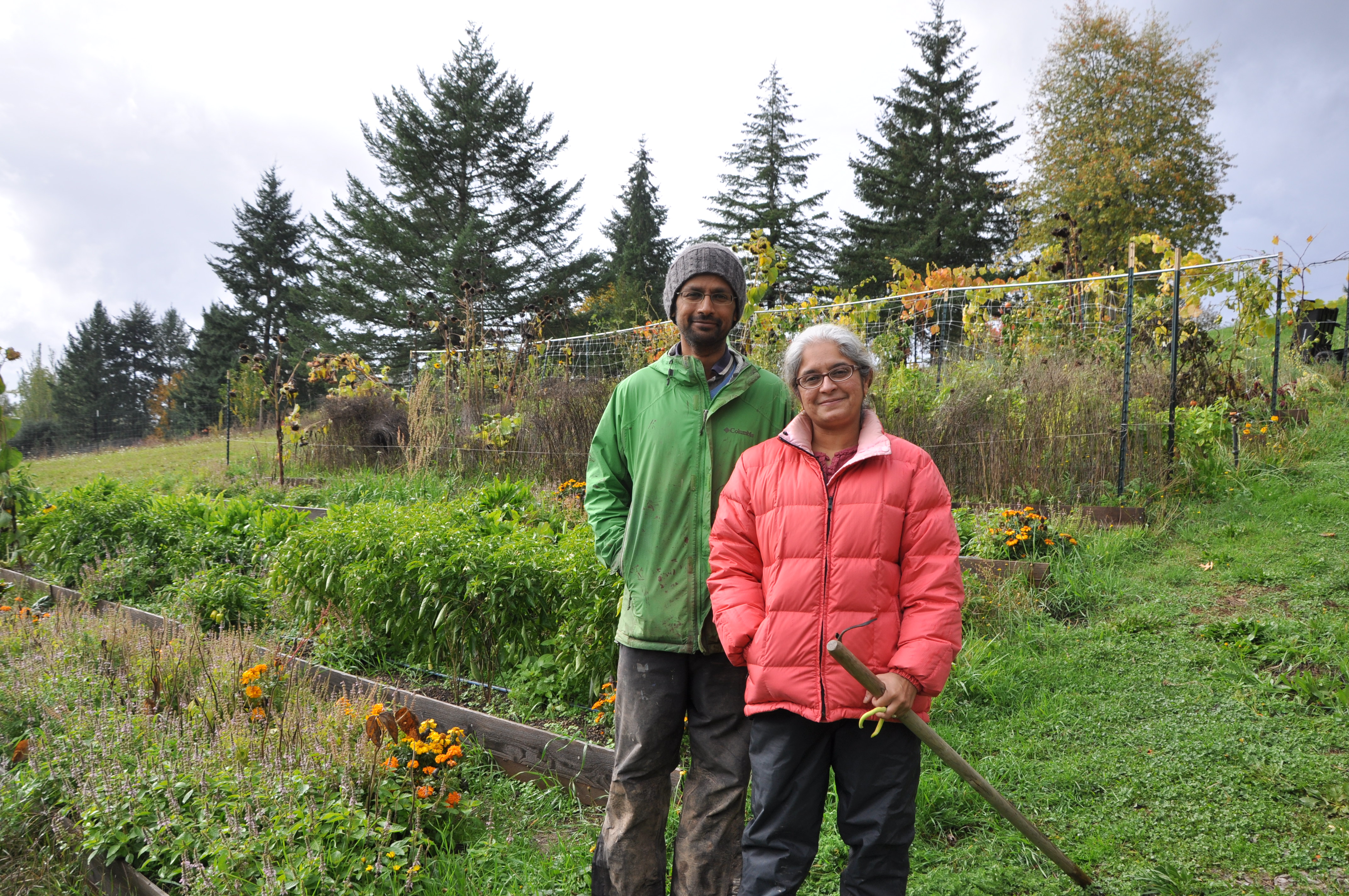 Ganesh and Lakshmi proudly stand on their half-acre organic vegetable farm called Edible Stories. Photo: Tracy Robillard.