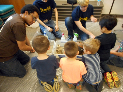 NRCS Employee Chris Davis teaches preschools about FFA Students and NRCS professionals teach preschoolers about farm-fresh food sources, soil profiles, seed planting and planned their visit to a Findlay People's Garden