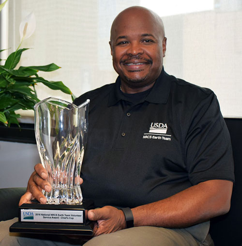 Ohio State Conservationist Terry Cosby with the Chief's Cup award.