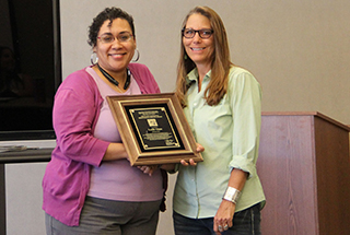 State Conservationist, Keisha Tatum, presented a plaque to Leslie Glass on behalf of Arizona NRCS and National Plant Materials Program Leader, John Englert.
