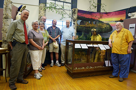 Members of NRCS-Maine and the Vassalboro Historical Society gather around the