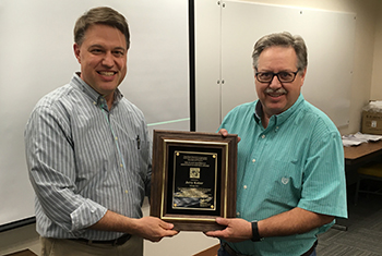 John Englert, Plant Materials program leader (L) presents Jerry Kaiser, plant materials specialist (R) with a  meritorious service award plaque.