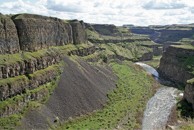 Distinct, sharp breaks between landforms are evident over short lateral distances, as shown by the talus cone in this canyon along the Palouse River in Washington.