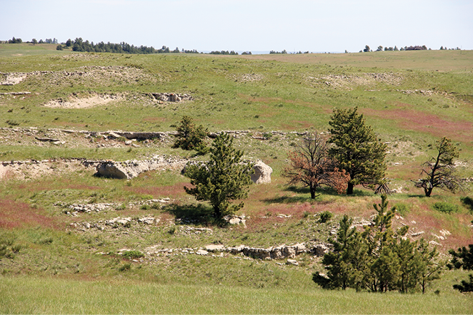 Figure 2-13. Complex slopes on a hillslope of interbedded sedimentary rocks in Wildcat Hills, Nebraska.