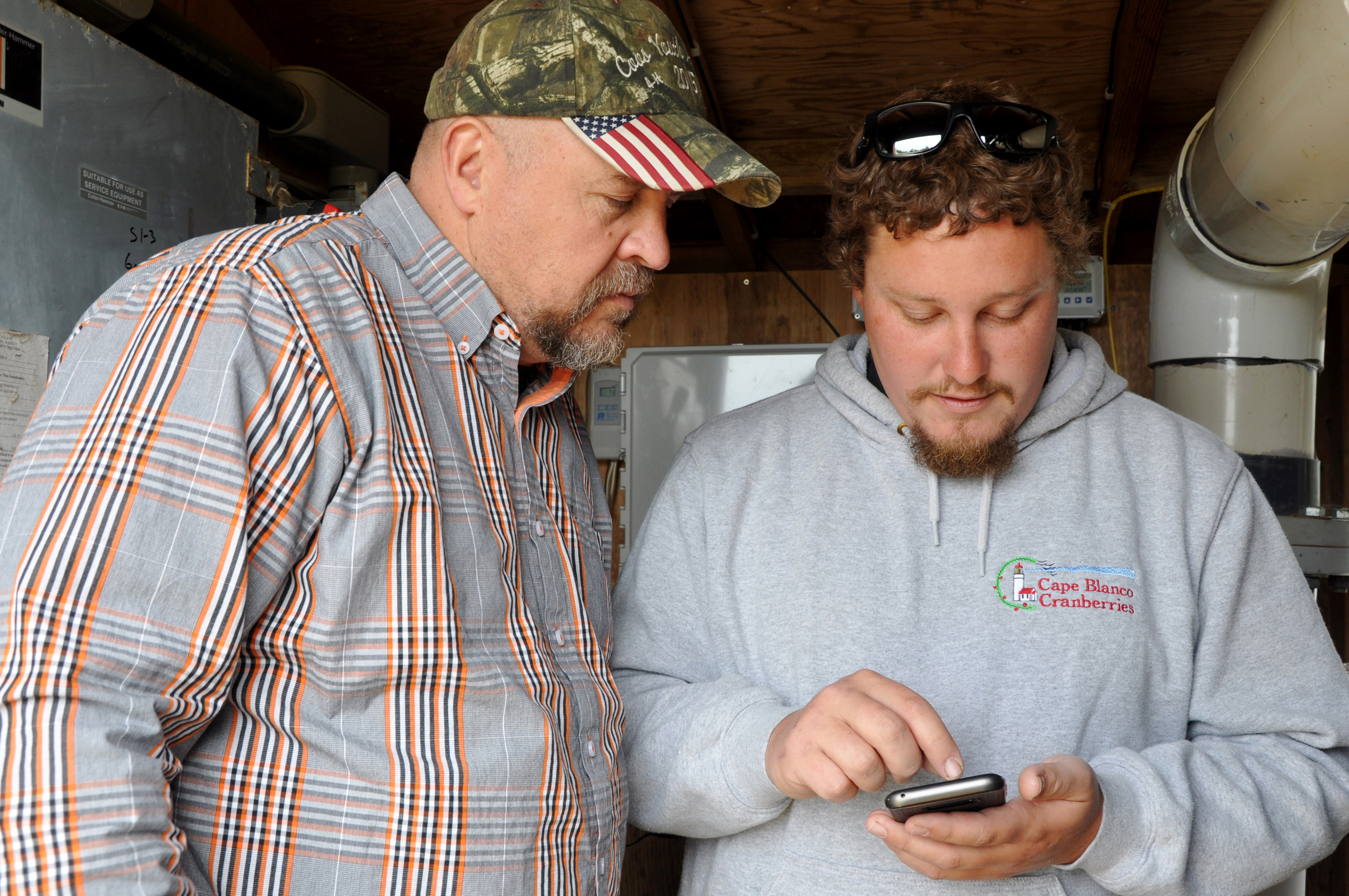 Nick shows Eric how easy it is to control his automated irrigation system with a few swipes on his smartphone.