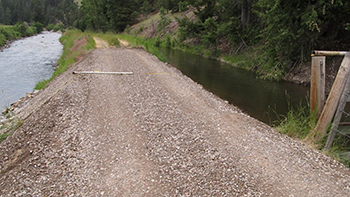 Canal breach repaired to facilitate continued use of the irrigation system and access to the irrigation diversion structure.